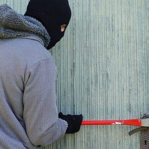Masked Man Breaks Lock in Burglary